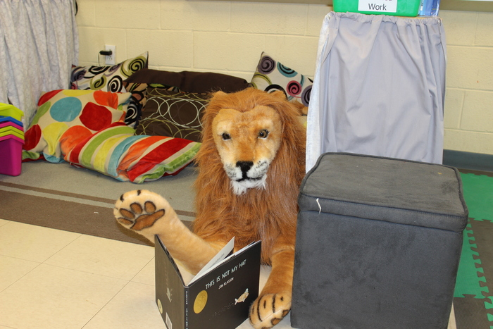 Leo found a book in the reading nook in Ms. Piesla and Ms. Stark's class.