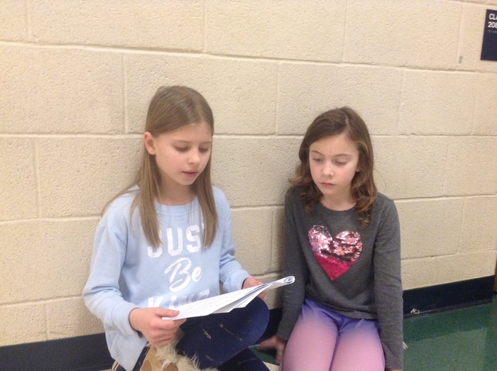 Sharing writing stories with 2nd grade buddy class.