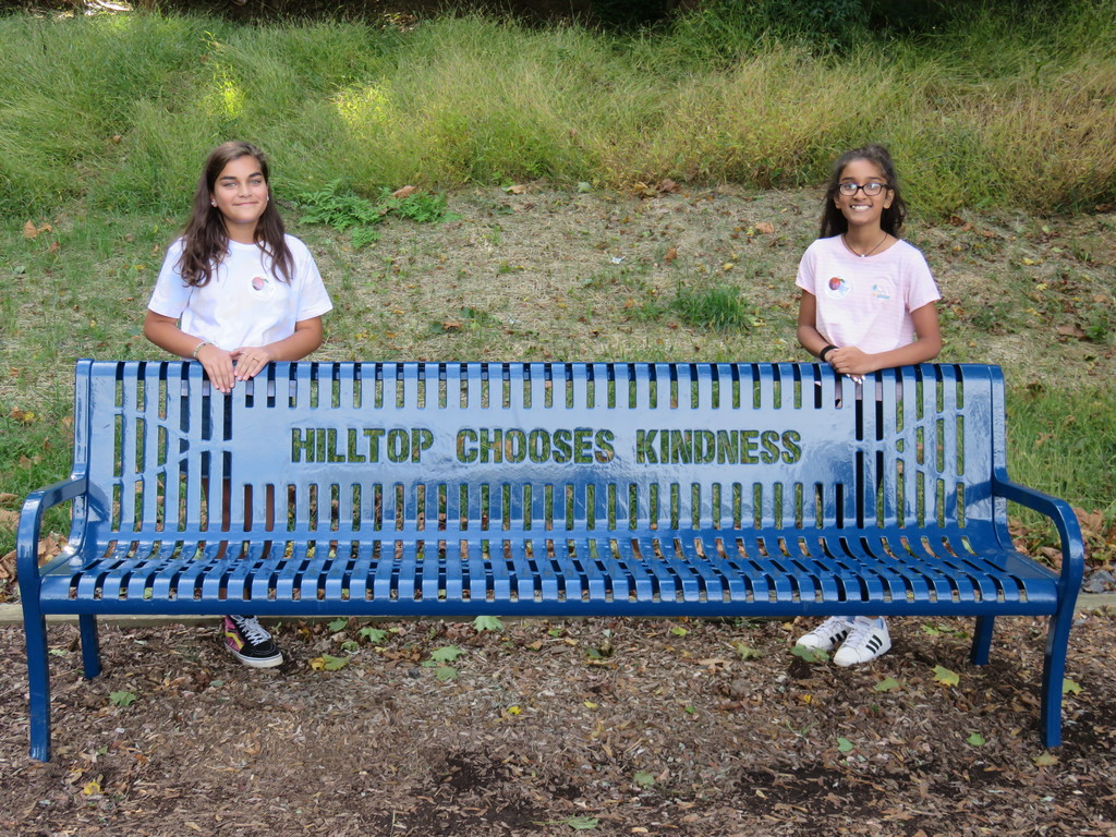 Hilltop grads who petitioned for a Buddy Bency through their Positivity Club.  Bench purchased with funds from the Mendham Municipal Alliance.