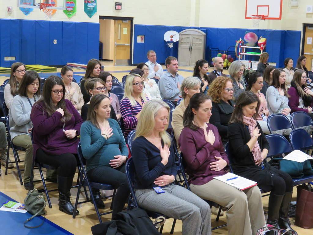 Teachers practice mindful breathing
