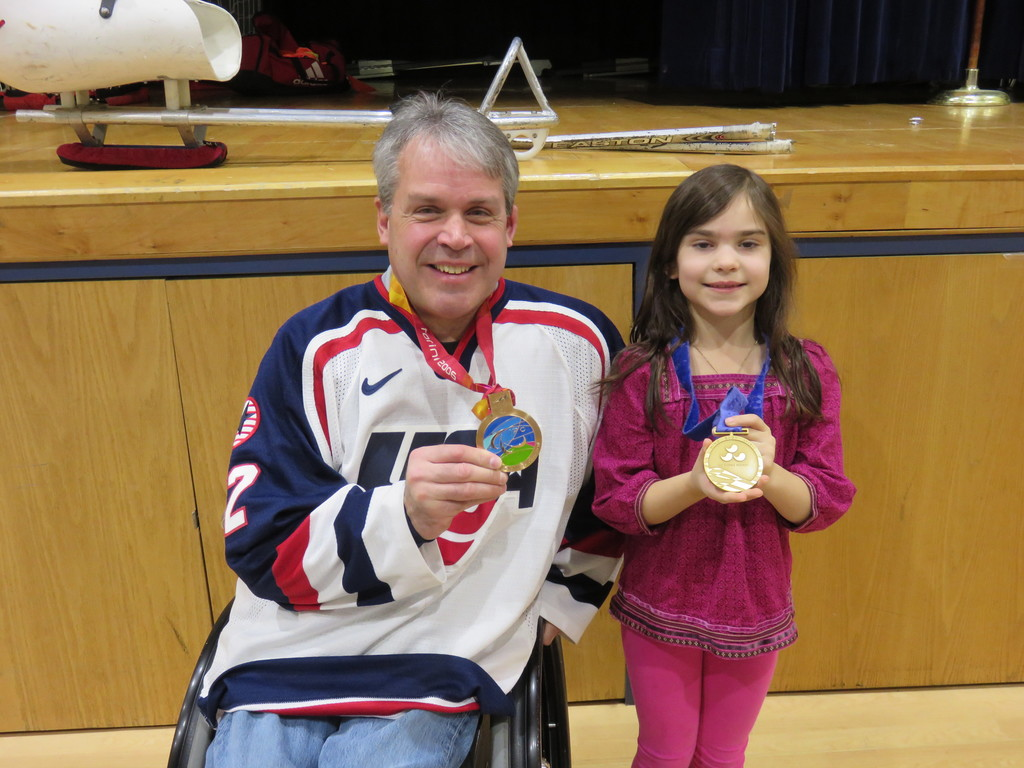 Kip St. Germaine and his gold and bronze medals in sled hockey in the paralympics