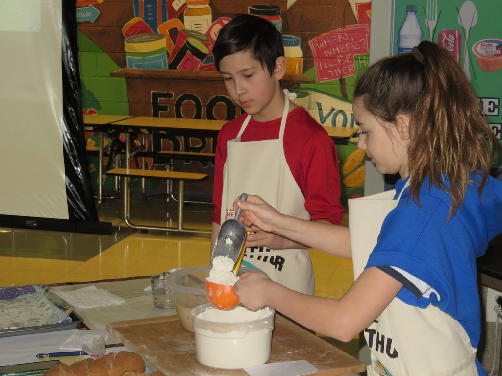 Baker's Assistants make dough for the class